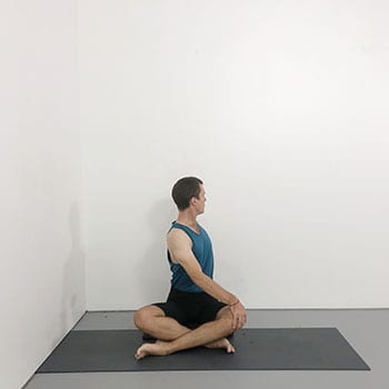 simple cross leg twist iyengar yoga pose